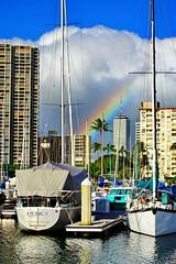 A surprise rainbow! (peggyhr) Tags: peggyhr marina rainbow ocean city cloudssky sailboats sunlight shadows reflections dsc07432a hawaii thegalaxy interestingviews thegalaxystars thegalaxylevel2 halloffamegallery thegalaxylevel2halloffame