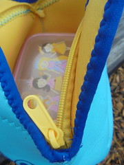 DSC01757 (classroomcamera) Tags: lunch lunchbox lunchboxes lunches yellow blue teal zipper zippers open close down below up above inside outside outdoors girl girls plastic tupperware container containers teeth closeup
