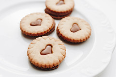 Close up of group of biscuits with chocolate hearts (wuestenigel) Tags: bake cake dessert romantic sweet day brown background snack biscuit delicious love pile valentines assortment white sugar chocolate gift closeup hearts bakery tasty colorful food romance holiday assorted cookie valentine color decoration cookies heart nobody treats pastry traditional