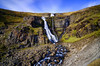 A pretty roadside fall (_Amritash_) Tags: waterfall cascade landscapes landscape iceland icelandiclandscapes longexposure prettyroadsidewaterfall rocks rockstrata escarpment hill cliffs glacial glacialmelt