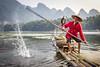 Splash (lc99photography) Tags: fisherman cormorant cormorantfisherman cormorantfishing water splash river lijiang liriver karst karstformation raft bambooraft birds oldman red oar fun playful landscape guilin guangxi