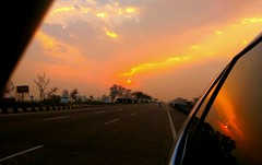 Fiery Morning (camaee29) Tags: sunlight sun clouds road sky yellow orange reflection yureka patiala morning sunrise car india cool