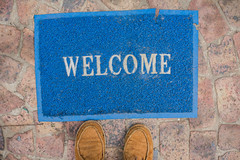 Welcome (Rushay) Tags: blue feet mat sign standing welcome welcomemat