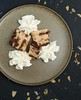 Chocolate liquor bread pudding and decorative whipped cream. (annick vanderschelden) Tags: chocolate liquor bread pudding pressurecooker slices milk egg pottery plate served layering frosting baking food decorative whippedcream cream belgium