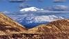 Mount Hood, Oregon, with devastated forests of Mount St. Helens, Washington, in foreground, c1985. (edk7) Tags: nikonnikkormatft2 colournegativefilm edk7 c1985 us usa pacificnorthwest washington skamaniacounty mountsthelensnationalvolcanicmonument mountsthelens stratovolcano cascaderange cascadevolcanicarc devastatedforest mounthood clackamascounty hoodrivercounty oregon geology snow sky cloud mountain valley peak ridge landscape vista