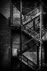 Black and White Stairs (Rohit KC Photography) Tags: blackandwhite bw stairs metals classic architecture edited lighting dark moody wall metal vertical canon canon5dmarkii canoneflens canon24105mmf4l usasacramento unitedstatesofamerica ca california loveforblackandwhite photography amateur photographerlife photographylife nice bold