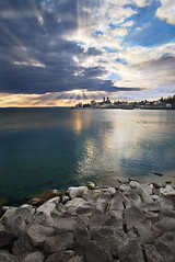 Sunrays Over Friedrichshafen Palace (johaennesy) Tags: sunrays evening lightrays friedrichshafen germany badenwürttemberg bodensee landscape vertical opensourcesoftware gimp rawtherapee luminancehdr clouds lake water lakeconstance stones pentaxian crepuscularrays