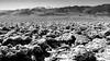 Death Valley 166 (Tasmanian58) Tags: deathvalley desert salt mountain telescopepeak bw blackandwhite loxia zeiss sony a7ii sky snow rocks geology landscape loxia235
