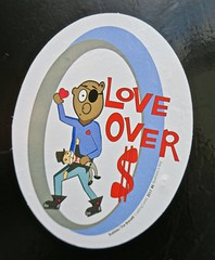 Love Over $, Oakland, CA (Robby Virus) Tags: oakland california ca east bay sticker slap money love heart monopoly man bear eye patch bubbles brave trading cards realness key