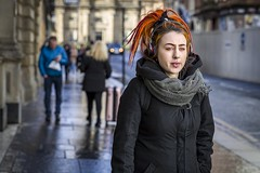 A Complimentary Colour (Leanne Boulton) Tags: portrait people urban street candid portraiture streetphotography candidstreetphotography candidportrait streetportrait streetlife woman female girl face expression eyes look emotion mood dreadlocks piercing bright orange hairstyle complimentary blue tone texture detail depthoffield bokeh naturallight outdoor light shade shadow city scene human life living humanity society culture fashion canon canon5d 5dmkiii 70mm ef2470mmf28liiusm color colour glasgow scotland uk