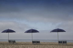 Solitude (remiklitsch) Tags: beach ocean umbrellas chairs sand sky clouds blue santamonica pattern nikon remiklitsch alternatingrhythym peacefulness calm serenity dogwood2018 dogwood2018week6 viewpointgallery fusionartps