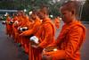 waiting for alms (geneward2) Tags: alms buddhism orange chiang mai thailand monk