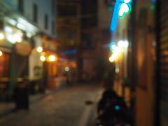 Νight's dizziness (periStatic) Tags: night thessaloniki greece black lights outdoor street alley pub ladadika moto drunk dizzy old yellow