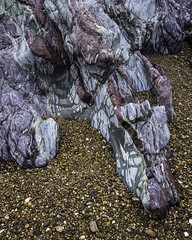 The Dragon Sleeps....or....Geology for the completely indifferent! (markrd5) Tags: rocksrocksandmorerocks geologyforthenonplussed welshdragon llandwynisland porthtwrbach manicstreetpreachers motorcycleemptiness intrusivedoleritedykes