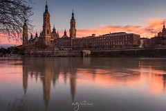 Sunset in Zaragoza (Pastel Frames Photography) Tags: spain zaragoza sunset canon5dmark3 canon1635mm basilica travelphotography travel photography sightseeing clouds reflection river flow