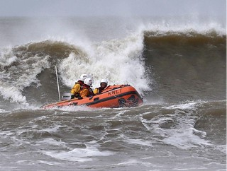 Porthcawl RNLI D-Class lifeboat in the surf at Rest Bay