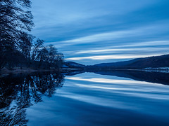 Meiklie Dawn Blues (Highlandscape) Tags: iainmacdiarmid landscape mirror reflection outdoor rural weather lochletter stninians unitedkingdom highland kilmartinhouse glen cloud twilight glenurquhart highlandscapezenfoliocom uk balnain olympus natural calm highlands water beauty solar colour em5markii trees lochmeiklie dawn scotland sunrise ecosse spring a831 countryside sky kilmartin highlandscape hill rocks loch tree