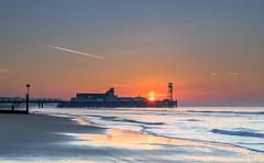 Pier Sunrise (nicklucas2) Tags: seascape beach lowtide sea sand pier bournemouth contrail sun sunrise seaside
