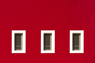 Three Windows in a red wall