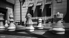 Games People Play (Little Hand Images) Tags: chess outdoorchess brickchessboard white black mall weighted blueawnings bench wroughtiron