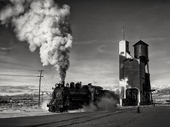Steam, Steel and Snow (rolfstumpf) Tags: usa nevada nevadanorthern nnry93 ely steam locomotive coal coalingtower monochrome blackwhite blackandwhite bnw olympus evening sunset snow winter cloud shadows