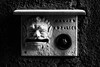 nameplate (Francis Mansell) Tags: doorbell nameplate monochrome venezia venice blackwhite demon gargoyle wall mailbox face mouth
