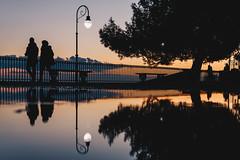 Spianata silhouette (FButzi) Tags: genova genoa liguria italia italy people tree sunset dusk street lamp spianata castelletto