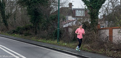 Sunday Run 3 (M C Smith) Tags: running woman road pink kerb pavement woodland green white black ivy houses lines pentax k3 sky wall garage aerials grey litter branches