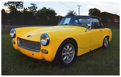 1967 Austin Healey Sprite (daveelmore) Tags: 1967austinhealeysprite 1967 austinhealey sprite car coupe roadster convertible automobile vehicle yellow lotsofextraparts stitchedpanorama panorama lumixleicadgsummilux25mm114