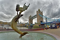 Girl with a Dolphin (Geoff Henson) Tags: girl dolphin statue sculpture fountain pond river bridge water clouds sky towers london fisheye outside march 1500v60f