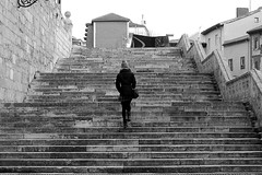 The stairs (Daniel Nebreda Lucea) Tags: stairs escaleras black white blanco negro city ciudad urban urbano girl woman chica mujer up subir going ir motion movimiento monochrome monocromatica texture textura old vieja antigua lines shapes formas canon 50mm 60d burgos spain españa europe europa travel viajar walking andando people gente architecture arquitectura building construccion structure estructura town pueblo stone piedra