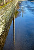 11 Wet (manxmaid2000) Tags: water rain puddle road reflection lane roadside gutter wet surface wall tree pole shower stone reflected isleofman rural flood downpour