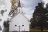 already (roadkill rabbit) Tags: church driving spring louisiana light smoke glare