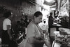 The Cook (D. R. Hill Photography) Tags: bangkok thailand thai asia southeastasia street streetphotography blackandwhite monochrome 135 35mmfilm analog film ilford ilforddelta3200 grainy grain nikon nikonfe2 fe2 voigtlander voigtlandercolorskopar28mmf28 colorskopar 28mm cosina primelens fixedfocallength manualfocus wideangle