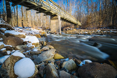 Creek Crossing (tquist24) Tags: brandywinecreek cuyahogavalleynationalpark nikon nikond5300 ohio outdoor bridge footbridge geotagged landscape longexposure nature park river rock rocks sky snow tree trees water winter northfield unitedstates
