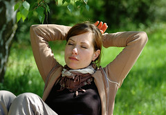 Enjoying the spring sun (gornabanja) Tags: woman portrait eyesclosed closedeyes sunshine sun garden green grass content happy nikon d70 family