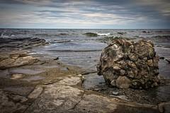 Ontario Beachball (delmarvajim) Tags: lake landscape shoreline rocks dramatic clouds water waves