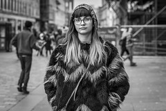 It's Not Wise To Upset A Wookie (Leanne Boulton) Tags: portrait people urban street candid portraiture streetphotography candidstreetphotography candidportrait streetportrait eyecontact candideyecontact streetlife woman female girl face expression eyes look emotion mood feeling winter fur furry faux wookie humour hair fringe blending tone texture detail style fashion depthoffield bokeh naturallight outdoor light shade city scene human life living humanity society culture canon canon5d 5dmkiii 70mm ef2470mmf28liiusm black white blackwhite bw mono blackandwhite monochrome glasgow scotland uk
