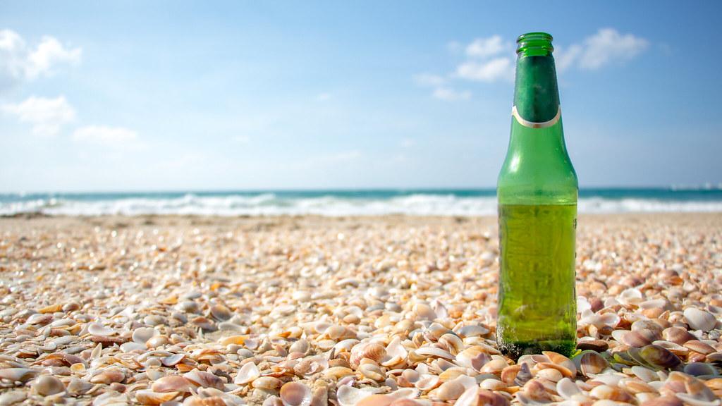 Bear bottle on the beach