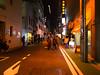 Jinbocho (ademilo) Tags: street streetphotography streetlight construction pedestrians people neon night nightscape city cityscape tokyo japan gr2 gr group richo