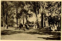 [Boys swinging on playground maypole swing] (State Library of Massachusetts) Tags: children playground swings maypoleswing