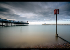 /--------I---- (Kevin HARWIN) Tags: water sea wet sand beach stones rocks pier sign blue sky long exposure red afternoon canon eos m3 sigma 1020mm lens herne bay south east kent uk engalnd england tripod filter tenstop