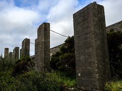 Concrete sentinels, Leswidden China Clay Works (Rogpow) Tags: cornwall leswiddenchinaclayworks mine stjust stjustinpenwith penwith concrete fujifilm fuji fujixpro2 abandoned derelict decay disused dilapidated ruin overgrown industrialhistory industrialarchaeology industrial industry chimney chinaclay chinaclayworks leswidden clouds