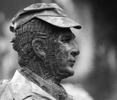 NB#027 (Frédéric ROBIN) Tags: statue man homme sculpture face visage war guerre military soldier soldat militaire art balle bullet iron fer acier steel ilford argentique demeureduchaos adobeofchaos