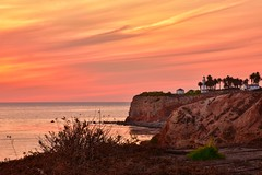 Fantasy Island (kirstenscamera) Tags: lighthouse pointvicente ranchopalosverdes cliffs interpretivecenter outside beach coastalphotography california westcoast socal ca sky sunset water pacificocean orangesky horizon buildings palmtrees nikon d810 unitedstates trail terranea resort seacaves pirates evening palosverdes striations serene
