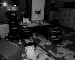 Abandoned Jaguar Dealership: Manager's Office (that_damn_duck) Tags: blackwhite monochrome abandoned debris urbex urbanexplorer jaguardealership cardealership papers desk filecabinet bw blackandwhite