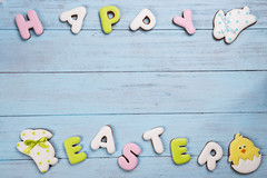 Cookies lettering Happy Easter with rabbit card on wooden blue background. (lyule4ik) Tags: easter background celebration decoration decorative egg food holiday season spring tradition wood wooden happy cookies concept design natural rustic springtime texture traditional banner biscuits card celebrate closeup eggs filter flower wishes toned sprinkles white colored letter brown nest frosting bright homemade basket horizontal april shortcrust text sweet chicken nobody bakery