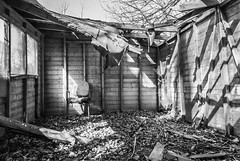Decayed shed 2 (Rob A Dickinson) Tags: nikon d80 nikon18200 wrecked shed abandoned decay derelict chair blackandwhite monochrome dilapidated essex eastanglia