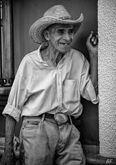 I'm a poor lonesome cowboy (poupette1957) Tags: art atmosphère black canon city curious costumes detail guatemala antigua humanisme imagesingulières life monochrome man photographie people portrait rue street hat town travel urban ville voyage