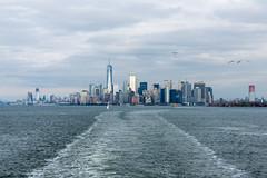 Manhattan skyline from the Staten Island Ferry. (MikePScott) Tags: birds boat buildings builtenvironment camera clouds featureslandmarks ferry lens manhattan newyork newyorkcity newyorkharbour nikon2470mmf28 nikond600 sea seagull sky skyscraper statenislandferry usa unitedstatesofamerica